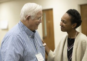 Alabama Arise member Lawton Higgs speaks with Gabrielle Daniels of the Equal Justice Initiative during Arise's 2019 annual meeting in Montgomery.