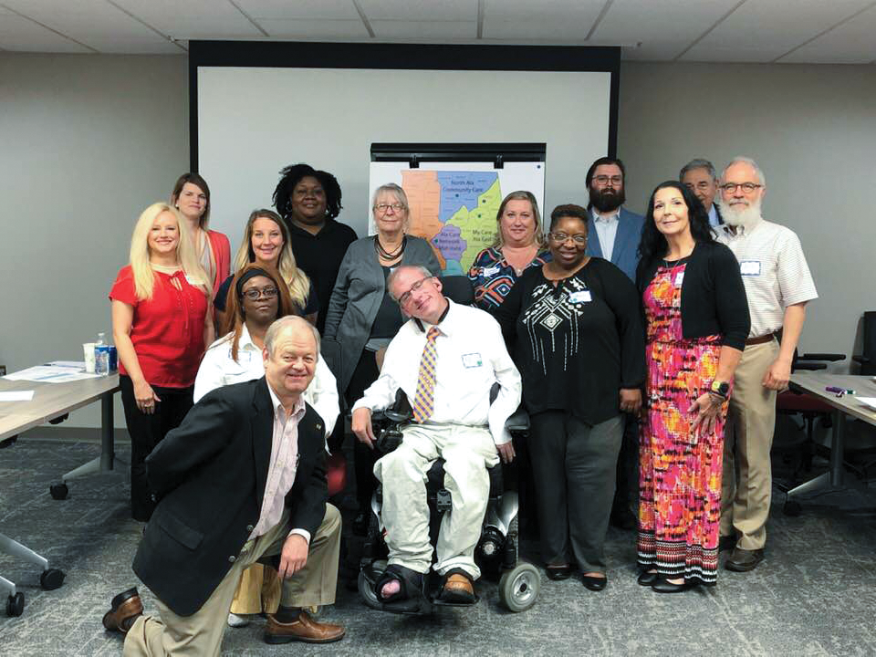 A group photo of Medicaid consumer representatives and other advocates.