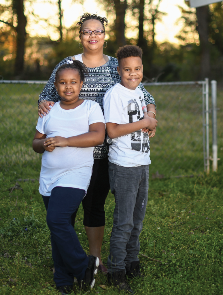 A photo of Formeeca Tripp with her two children.